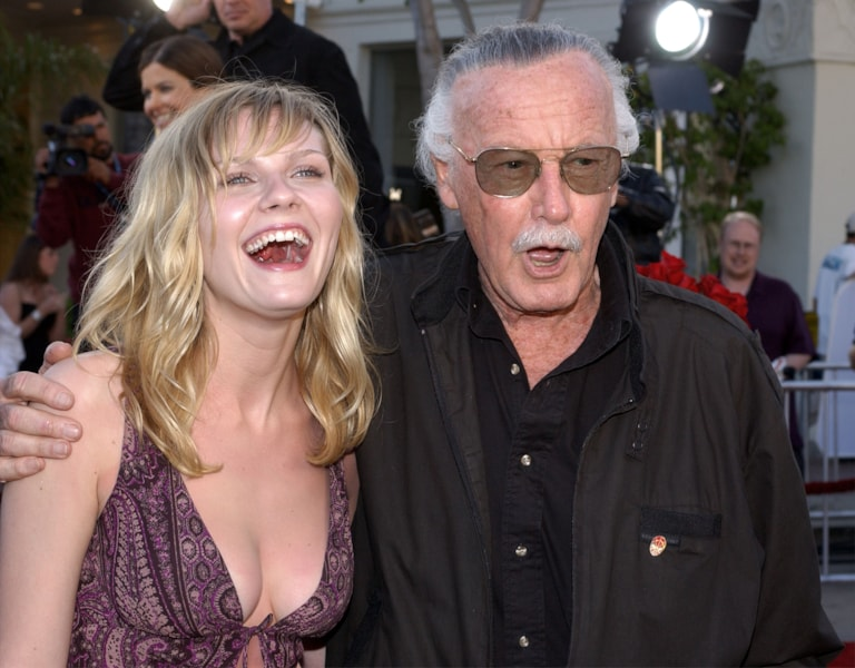 """Spider-Man comic book creator Stan Lee (R) and actress Kirsten Dunst arrive at the premiere of the film """"Spider-Man"""" April 29, 2002 in Los Angeles, CA. (Photo by Vince Bucci/Getty Images)"""