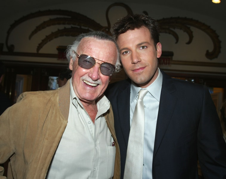 "LOS ANGELES - FEBRUARY 9:  Executive Producer Stan Lee (L) and actor Ben Affleck pose in the lobby at the premiere of ""Daredevil"" at the Village Theatre on February 9, 2003 in Los Angeles, California. (Photo by Kevin Winter/Getty Images)"