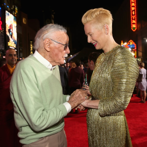 """HOLLYWOOD, CA - OCTOBER 20:  Executive producer Stan Lee (L) and Actress Tilda Swinton, wearing Haider Ackermann, attend The Los Angeles World Premiere of Marvel Studios? """"Doctor Strange? in Hollywood, CA on Oct. 20th, 2016.  (Photo by Jesse Grant/Getty Images for Disney)"""