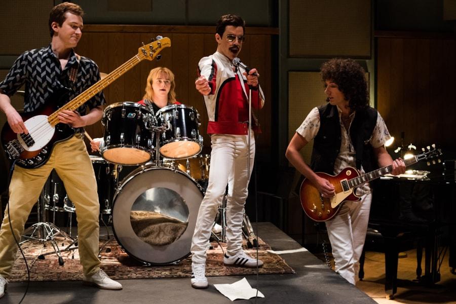 L-R: Joe Mazzello (John Deacon), Ben Hardy (Roger Taylor), Rami Malek (Freddie Mercury), and Gwilym Lee (Brian May) star in Twentieth Century Fox's BOHEMIAN RHAPSODY.