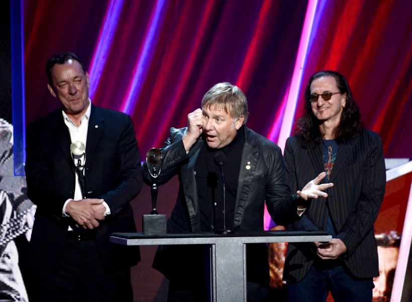 LOS ANGELES, CA - APRIL 18:  (L-R) Inductees Neil Peart, Alex Lifeson and Geddy Lee of Rush speak on stage at the 28th Annual Rock and Roll Hall of Fame Induction Ceremony at Nokia Theatre L.A. Live on April 18, 2013 in Los Angeles, California.  (Photo by Kevin Winter/Getty Images)