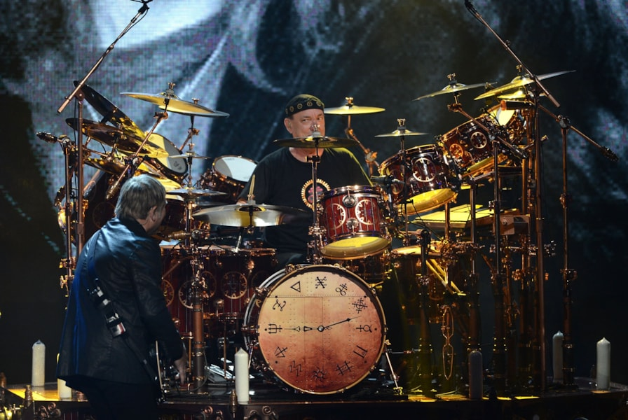 LOS ANGELES, CA - APRIL 18: (L-R) Inductees Alex Lifeson and Neil Peart of Rush perform onstage at the 28th Annual Rock and Roll Hall of Fame Induction Ceremony at Nokia Theatre L.A. Live on April 18, 2013 in Los Angeles, California.  (Photo by Kevin Winter/Getty Images)