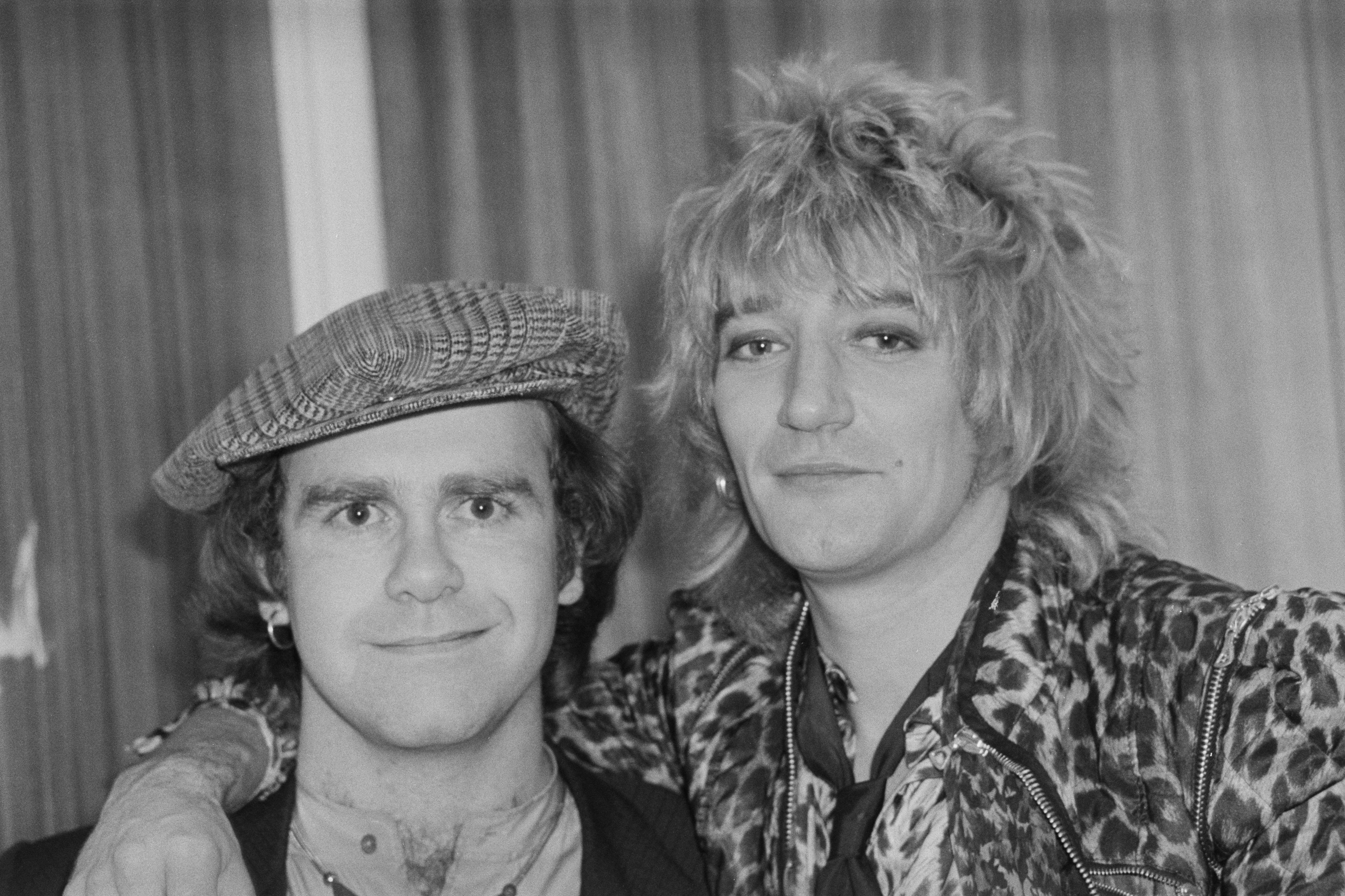 British singer, pianist and composer Elton John with British rock singer and songwriter Rod Stewart at the Olympia, London, UK, 22nd December 1978. (Photo by Evening Standard/Hulton Archive/Getty Images)