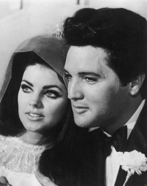 American rock n' roll singer and actor Elvis Presley (1935 - 1977) with his bride Priscilla Beaulieu after their wedding in Las Vegas.  (Photo by Keystone/Getty Images)
