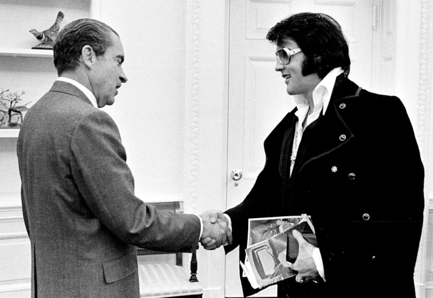President Richard Nixon shakes hands with Elvis Presley December 21, 1970 at the White House. (Photo by National Archive/Newsmakers)
