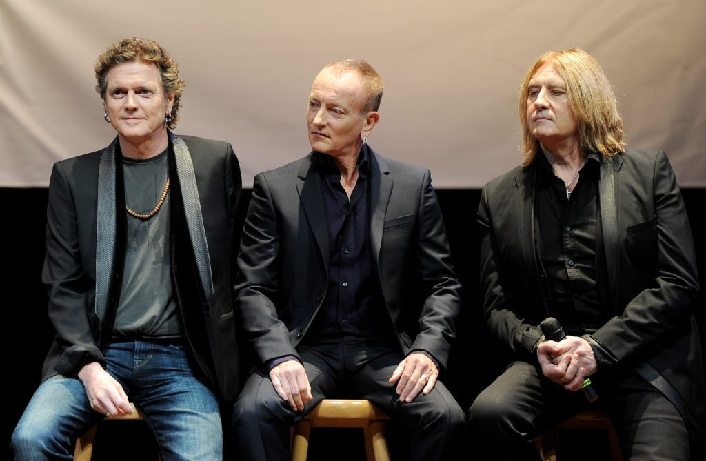 "WEST HOLLYWOOD, CA - MARCH 17:  (L-R) Musicians Rick Allen, Phil Collen and Joe Elliott of Def Leppard announce the KISS and Def Leppard ""2014 Heroes Tour"" at House of Blues on March 17, 2014 in West Hollywood, California. Classic Rockers  (Photo by Kevin Winter/Getty Images for Live Nation)"