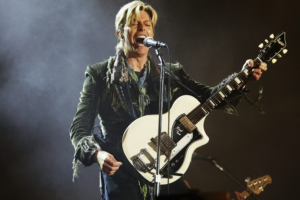 "NEWPORT, ENGLAND - JUNE 13:  David Bowie performs on stage on the third and final day of ""The Nokia Isle of Wight Festival 2004"" at Seaclose Park, on June 13, 2004 in Newport, UK. The third annual rock festival takes place during the Isle of Wight Festival which runs from June 4-19.  (Photo by Jo Hale/Getty Images)"