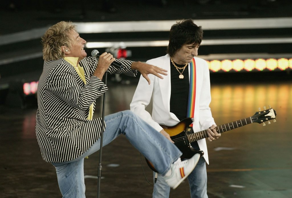 LONDON - JUNE 26:  Singer Rod Stewart and Ronnie Wood perform on stage at the Olympic Torch Concert held in The Mall on June 26, 2004 in London. The free concert - organised by Visit London and The Greater London Authority is  to celebrate the arrival of the Olympic torch in London. (Photo by Getty Images)