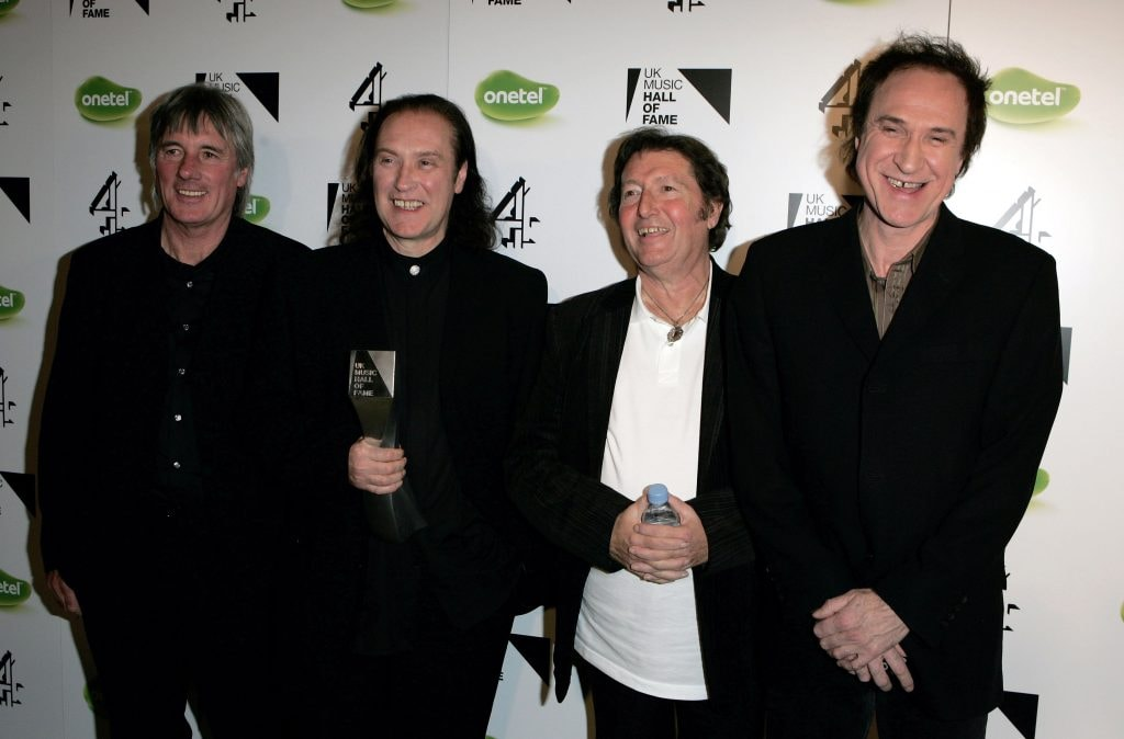 LONDON - NOVEMBER 16:  (L-R) The Kinks band members Mick Avory, Dave Davies, Peter Quaife and Ray Davies pose backstage with the award for their induction into the UK Music Hall Of Fame 2005, the culmination of the two-week Channel 4 series looking at 1950's-1990's popular music, at Alexandra Palace on November 16, 2005 in London, England. Acts are selected by a panel of over 60 artists, journalists, broadcasters and executives, with artists including Alanis Morissette, The Pretenders and Slash paying tribute to their fellow musical artists at the event.  (Photo by MJ Kim/Getty Images)